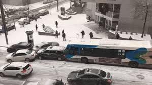 snow causes slow motion crash between cars and buses in montreal