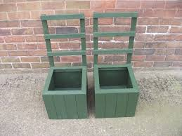 pair of new handmade wooden trellis planters in halfway south