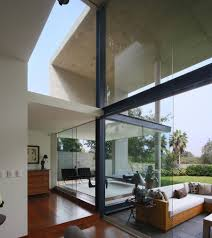 Concrete Ceiling Lighting by High Ceiling Lighting Including Large Glass Wall In Living Room