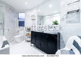 bright bathroom interior with clean clean bright stylish designer modern bathroom stock photo