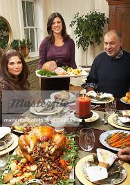 serving thanksgiving dinner stock photo masterfile