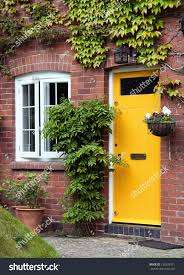 yellow front door entrance old style stock photo 133833371
