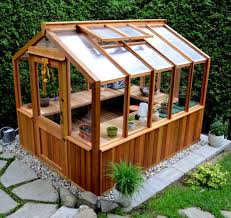 freestanding wood frame greenhouse by cedarbuilt makes a great she