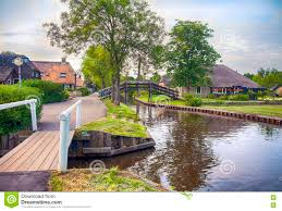 Giethoorn Holland Homes For Sale by Bridge And River In Old Dutch Village Giethoorn Stock Photo