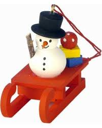 fall into savings on christian ulbricht snowman on sled ornament