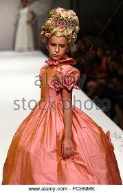 a kid model walks the runway at the nancy vuu fashion show during