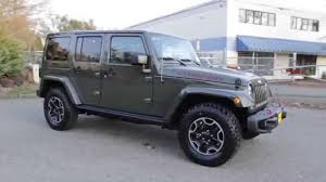 dark green jeep wrangler 2015 jeep wrangler unlimited rubicon hard rock edition green