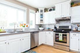 pictures of kitchens with white cabinets and dark floors the