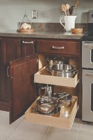 67 best organization images on pinterest kitchen kitchen a base cabinet with double roll trays keeps pots and pans conveniently at your fingertips