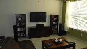 living room tv setup wood lacquered table or desk black television