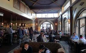 interior seating and bar at perch restaurant in los angeles ca