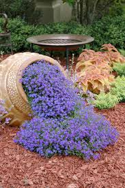 10 planters that will spill fragrant flowers into your garden