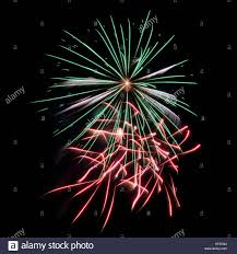 green red and white fireworks on black background flag colors