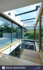 sliding glass panel doors the interior of a modern house on the coast large sliding glass