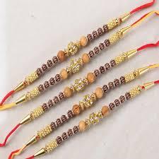 diamond studded rakhi buy bundle of five designer wooden diamond studded rakhi