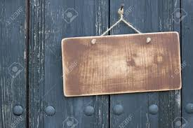 grunge wood frame blank with hanging on nail on dirty planks