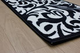 Floral Runner Rug Element Warwick Black Ivory Damask Rug Buy Rugs Online In The Uk