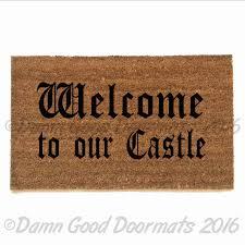 welcome to our castle by damn good doormats damn good doormats