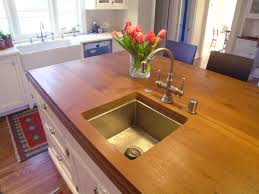 kitchen island featuring a teak wood countertop nott u0026 associates