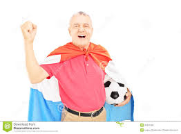 mature male sport fan with flag of holland holding a ball stock