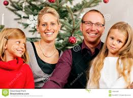 family in front of christmas tree stock photo image 16694586