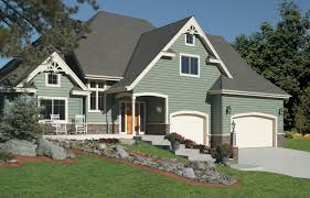Pictures Of Stucco Homes by 60 Residential Garage Door Designs Pictures
