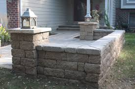 Paver Patio With VERSALOK Seat Wall In Lakeland Shores Garden - Patio wall design