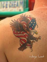 traditional colored american eagle and flag tattoo on shoulder