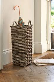 grey rattan umbrella stand from the holding company storage