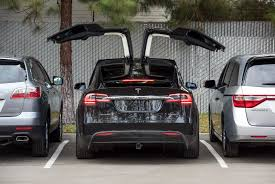 tesla outside tesla motors reboots referral program to encourage home charging
