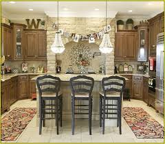 Above Kitchen Cabinet Decorations Best Top Of Kitchen Cabinet Decorating Ideas Photos Liltigertoo