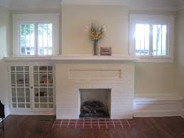 pretty old houses open house sunday virginia highland bungalow the fireplace is very craftsman with high windows and built ins on one side a book case other