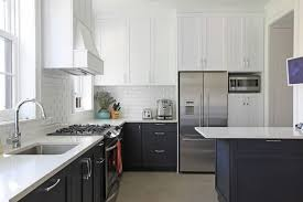 Transitional White Kitchen - caesarstone organic white kitchen transitional with black cabinets