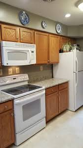 recycled countertops white kitchen cabinets with appliances