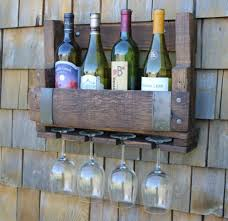 white wooden shelving unit with chrome metal wire glass wine
