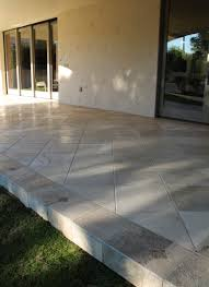 travertine flooring outside patio greenstone development