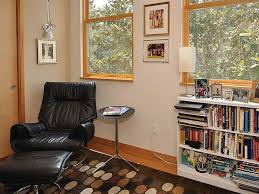 excellent reading corner design with wooden glass window and white