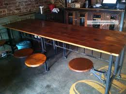 industrial table with 8 swinging stool attached post 1950 photo