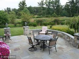 mediterranean patio with slate tile floors u0026 high ceiling in