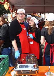 emmy rossum and fiance sam esmail volunteering at la mission s
