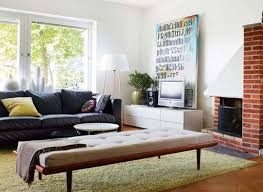living room living room with black section sofa with white