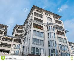 modern luxury apartment building with blue sky stock photo image