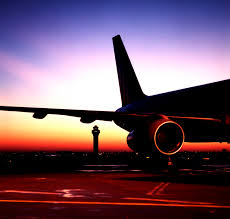 watch airplanes take off and land during sunset could do this all