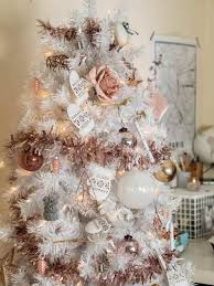 white tree with pink and gold decorations ne wall