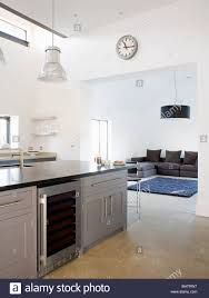 wine cooler in gray fitted island unit in open plan modern white