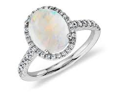 real blue opal opal and diamond halo ring in 18k white gold 10x8mm blue nile