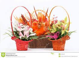 arrangement of beautiful fresh flowers in wooden basket stock