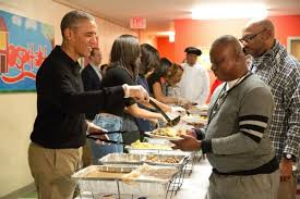 obama serves thanksgiving dinner to homeless spares turkeys upi