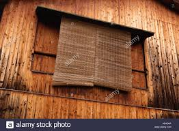 detail of bamboo window blinds in wooden house in traditional