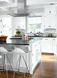 island exhaust hoods kitchen black and white kitchen features a stainless steel vent